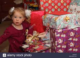 2 year old opening christmas presents stock photo royalty