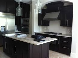 black cabinets and island dark wooden bar stools white pendant