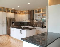 white kitchen cabinets with black countertops christmas lights