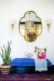 colorful entryway with a moroccan style mirror bright blue bench