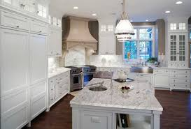 Remodeled Kitchens With White Cabinets by Thunder White Granite Pairs Well With The Pendant Lighting And