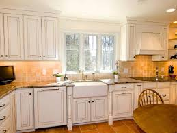 white wall color with classic kitchen cabinet using beige ceramic