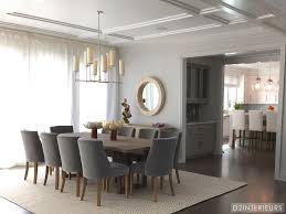 Coastal Dining Room Ideas by Gray Upholstered Dining Chairs Surround A Wood Dining Table In