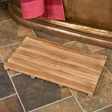 bathroom brown teak bath mat with teak shower stools on