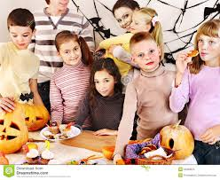 halloween party with children holding trick or treat royalty free