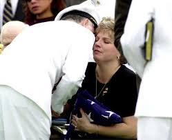 Stephanie Dunn, widow of Commander Patrick Dunn gets a kiss from - pdunn-04