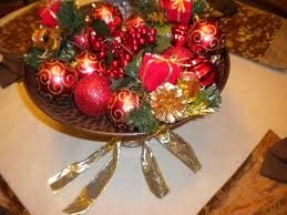 red balls with small gift box and red fruits placed on the golden