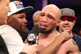 The first three quarters of the main event on Showtime Saturday night between IBF 154 pound champ K9 Bundrage and Ishe Smith were pretty putrid. - 002%2520Smith%2520victory%2520with%2520Mayweather%2520IMG_3101