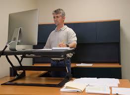 benefits of a standing desk healthyworks