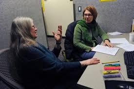 University of Colorado student Jenn Roark  left  receives help from writing consultant Nancy Mann
