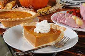 images of a thanksgiving dinner a slice of pumpkin pie on a thanksgiving dinner table stock photo