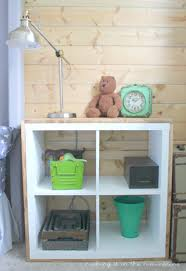 a plain white shelf with rustic charm aka an ikea kallax