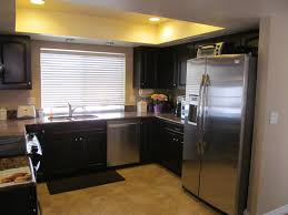 kitchen cabinets black kitchen cabinets grey walls wooden spoon