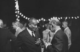 vintage two older men talking at party cocktails The Art of Manliness