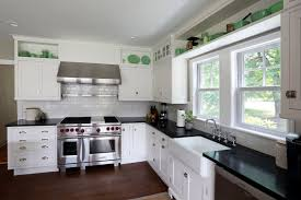 kitchen a kitchen with gas stove left then white sideboard and a