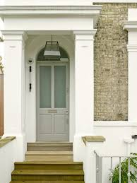 white doors with glass panels grey livingroom frontroom entry victorian with front steps