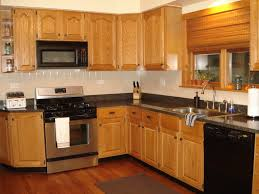 Best Paint For Kitchen Cabinets 2017 by Kitchen Gray Kitchen Cabinets And Backsplash With White Granite