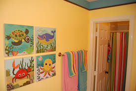 soothing bathroom color with colorful curtain and funny under sea