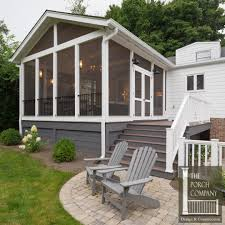Screen Porch Roof by Screened Porch And Garage Oasis The Porch Companythe Porch Company