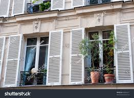 typical french windows balconies blinds paris stock photo 43667677