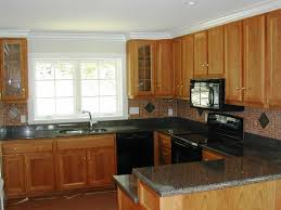 kitchen colors with oak cabinets and black countertops modern