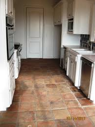 Kitchen Floor Tile Ideas With White Cabinets Antique Terracotta Saltillo Tile Really Adds To The Appeal Of This