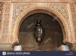 moorish archway and moroccan style light palace of alhambra stock