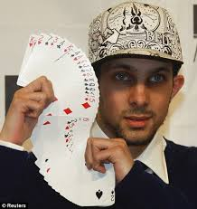 Dynamo Performing a fan with a deck of cards