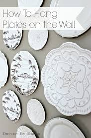 the easy how to for hanging plates on the wall driven by decor