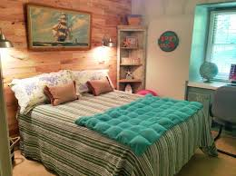Ocean Themed Bedding A Ship Paint On The Canvas Placed On The Light Brown Wooden Wall