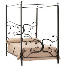 black wrought iron canopy bed with leaves ornament using cream bed