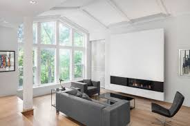 impressive home expansion offers huge living room window and