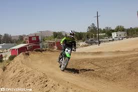 how to ride motocross bike kawasaki shows us how to ride dirt bikes drivingline
