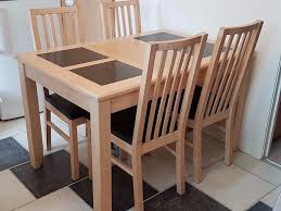 dining table and 4 chairs light maple wood with grey granite