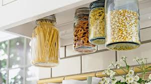 having jars hanged below the kitchen cabinets is one of the most