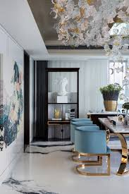 best 25 gold dining rooms ideas on pinterest gold and black gorgeous room blue and gold velvet chairs ceiling sculpture oversized art luxury dining