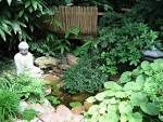 Japanese garden with buddha sculpture