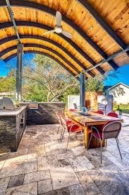 Design Your Own Outdoor Kitchen Patio With Modern Steel Roof And Outdoor Fireplace Hgtv Ultimate