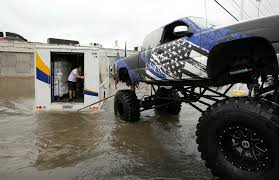 monster truck shows near me video monster truck pulls truck from flooded houston road