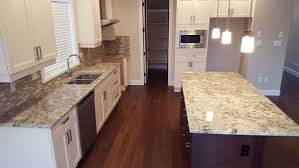 White Kitchen Cabinets With Black Granite Countertops by Granite Countertop Kitchen Cabinet Gallery Pictures White And