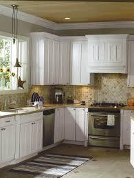 white wooden kitchen cabinet and beige tile backsplash added by