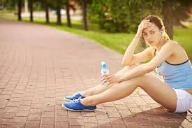 Confession  I Hate Exercise   Wellness   US News A young woman sits on the ground at a park with bottle of water