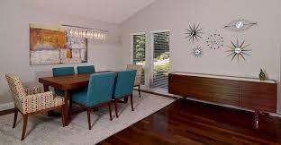 modern dining room with hardwood floors u0026 chandelier zillow digs