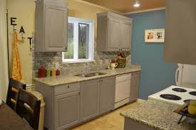 Oak Kitchen Cabinets Refinishing Grey Cabinets With Black Counters Wood Floors Countertops