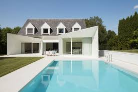 house and swimming pool front clean lined residence with swimming