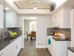 the crisp white and gray decor of this galley kitchen allows lots