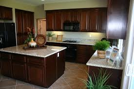 white marble countertops on varnished mahogany kitchen cabinets