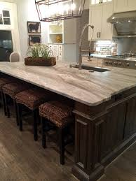 White Kitchen Cabinets With Black Granite Countertops by Light Granite River White Granite Kitchen Island Countertop