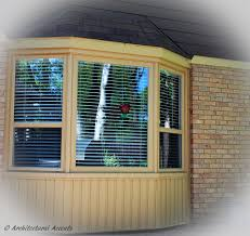 bay window with single hung windows on the sides and fixed window
