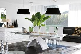 home design dining room with wooden table and black chairs beige
